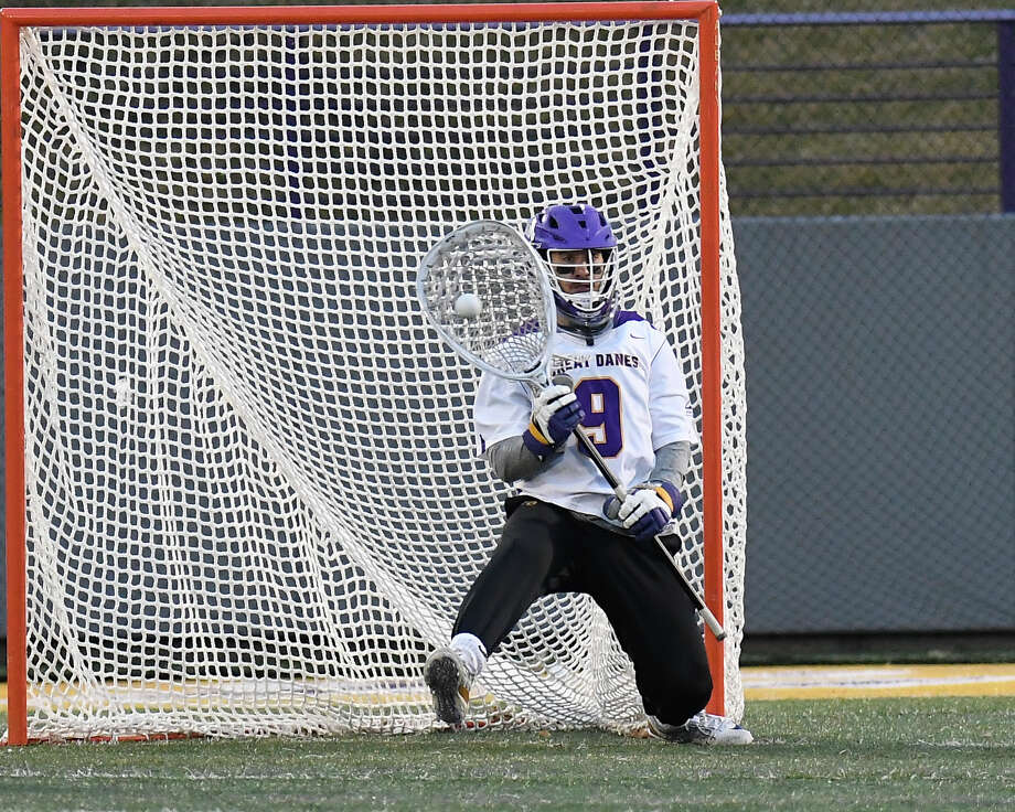 University at Albany's goal tender JD Colarusso (9) makes a save against Harvard during the first half of an NCAA men's college lacrosse game Wednesday, March 28, 2018, in Albany, N.Y. (Hans Pennink / Special to the Times Union) Photo: Hans Pennink / Hans Pennink