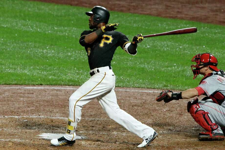 Pittsburgh Pirates' Starling Marte, left, drives in three runs with a triple off Cincinnati Reds relief pitcher Yovani Gallardo during the sixth inning of the team's baseball game in Pittsburgh, Friday, April 6, 2018. (AP Photo/Gene J. Puskar) Photo: Gene J. Puskar / Copyright 2018 The Associated Press. All rights reserved.