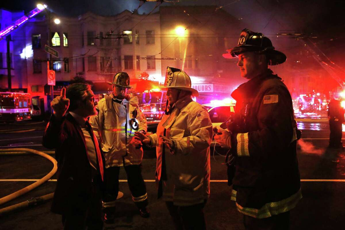 San Francisco Supervisor Aaron Peskin (left) talks with Fire Chief Joanne Hayes-White (right) during the North Beach fire on March 17.