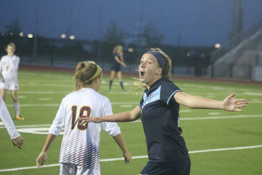 A member of the Kingwood Lady Mustangs expresses disbelief at the ruling by the side judge during Friday night's contest at Challenger Columbia Stadium. Photo: Robert Avery