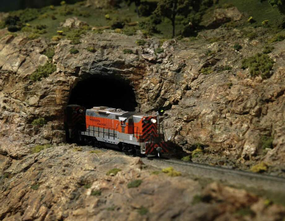 An HO scale train rolls through a tunnel at the Napa Valley Model Railroad Historical Society in Napa. Photo: Paul Chinn / The Chronicle / ONLINE_YES