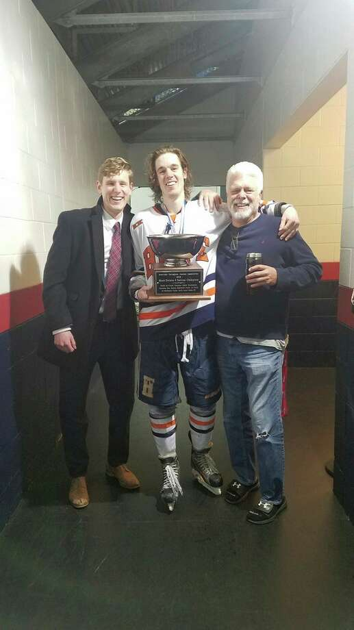 From left, brothers Caleb and Elliott Digison and their father, Scott, celebrate Hope College's first ACHA Division III national hockey championship on March 17 in Columbus, Ohio. Caleb is a Hope assistant coach and former player, while Elliott just finished his final season on the team. (Photo provided to Daily News/Scott Digison)