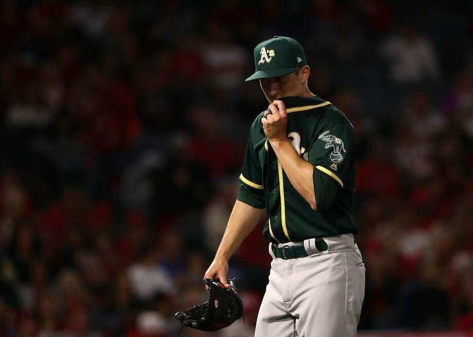 ANAHEIM, CA - APRIL 06:  Pitcher Daniel Gossett #48 of the Oakland Athletics wipes his face as he leaves the game in the fourth inning during the MLB game against the Los Angeles Angels of Anhaeim at Angel Stadium on April 6, 2018 in Anaheim, California.  (Photo by Victor Decolongon/Getty Images) Photo: Victor Decolongon, Getty Images