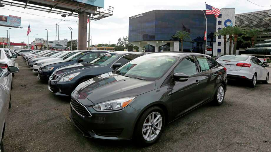 FILE- In this Jan. 17, 2017, file photo, certified pre-owned vehicles sit on display at an auto dealership in Miami. Used vehicle sales hit 39.2 million vehicles in 2017, more than double the number of new automobiles sold, according to the Edmunds.com auto website. (AP Photo/Alan Diaz, File) Photo: Alan Diaz / Copyright 2017 The Associated Press. All rights reserved.