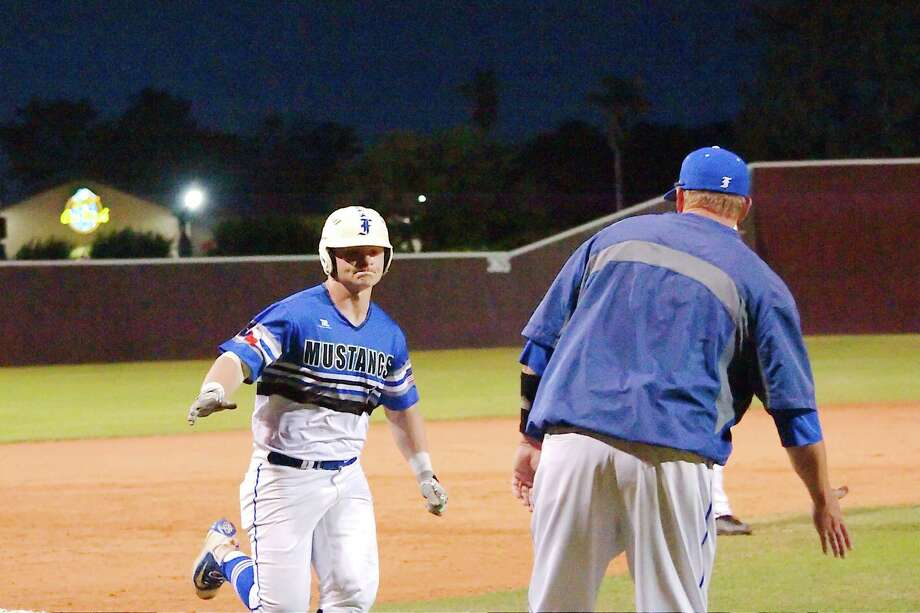 Friendswood baseball coach Steve Hecker congratulates Calvin Whiatker after his solo home run against Clear Creek Friday at Mallory Field. Photo: Kirk Sides / © 2018 Kirk Sides / Houston Chronicle
