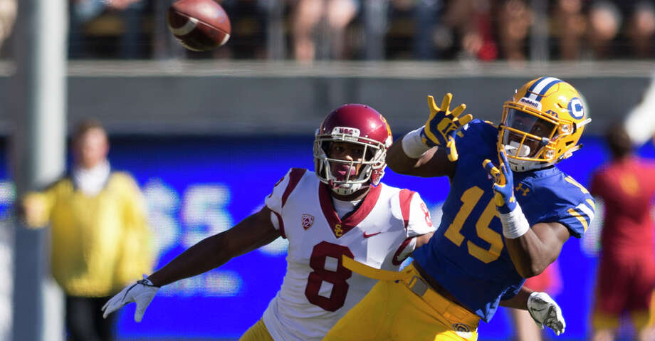 California's Jordan Veasy (15) catches a pass in front of Southern California's Iman Marshall (8) during the fourth quarter of an NCAA football game, on Saturday, Sept. 23, 2017 in Berkeley, Calif. USC won 30-20. Photo: D. Ross Cameron/Special To The Chronicle
