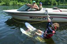 """Photos from Leaps of Faith """"Soaring with the Eagles"""" waterskiing day camp for the blind and visually impaired on the Housatonic River in Sandy Hook, Conn. Friday, June 27, 2014. """"Soaring with the Eagles"""" is a 4-day camp for kids ages six to 17 that teaches waterskiing, wakeboarding and tubing. Leaps of Faith Adaptive Skiers was founded in 1992 by former waterskiing world champion Joel Zeisler with the goal to build confidence through exposure to recreational and competitve waterskiing for disabled children and adults."""