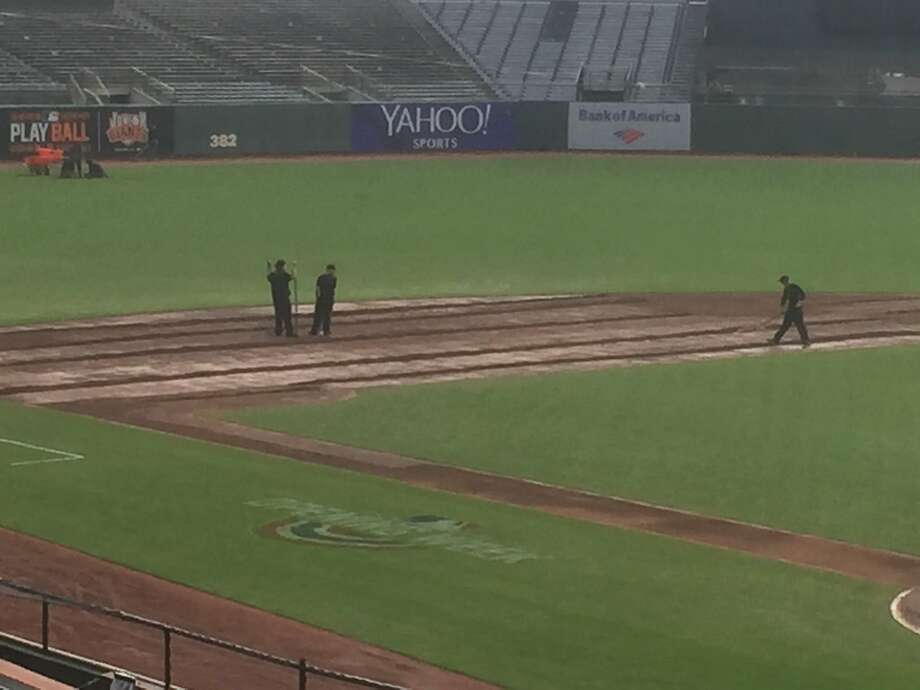 The Giants' grounds crew prepares the infield for Saturday's game. Photo: Henry Schulman / San Francisco Chronicle