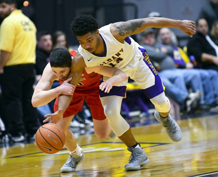 UAlbany guard David Nichols (13) will play at Florida State in 2018-19. (Hans Pennink / Special to the Times Union)