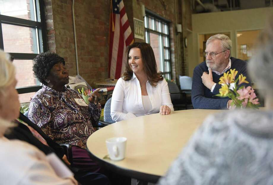 Intern Pamela Jimenez chats with seniors Ruby Berry and Ed Tucker at River House Adult Day Care Center in the Cos Cob section of Greenwich, Conn. Wednesday, April 4, 2018. Jimenez is a graduate student at Harvard working with seniors and the elderly for her master's degree. Photo: Tyler Sizemore / Hearst Connecticut Media / Greenwich Time
