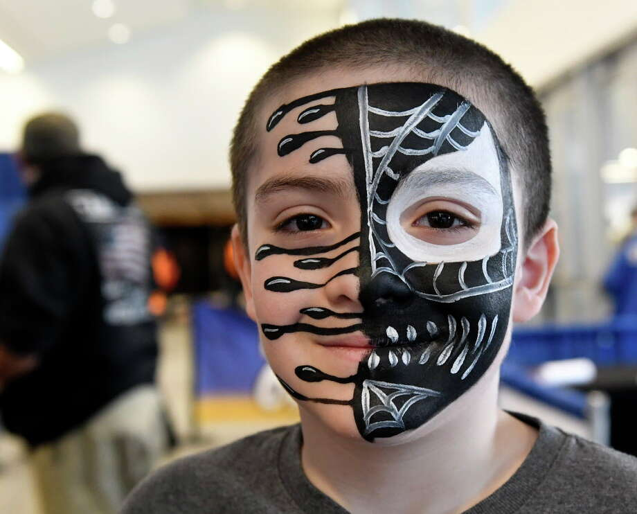 Preston Mathis age 9 years of Verona, N.Y., has his face painted as Venom of the Amazing Spider-Man series at the Empire State Comic Con festival Saturday, April 7, 2018 in Albany, N.Y. Photo: Hans Pennink, Times Union / Hans Pennink