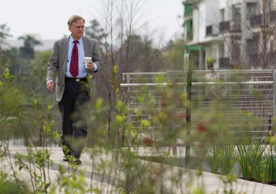 Robert Heineman, vice president of planning for The Woodlands Development Company, walks through a newly competed section of The Woodlands Waterway, an 18-year project combining commercial and residential centers with a 1.8 mile transit and pedestrian corridor through The Woodlands Town Center, Thursday, March 8, 2018, in The Woodlands. Photo: Jason Fochtman, Staff Photographer / © 2018 Houston Chronicle