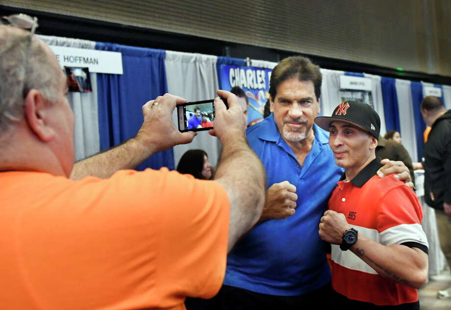 Event volunteer Glen Kane, left, takes a photograph of Incredible Hulk actor  Lou Ferrigno, center, and Fernando Garcia of Schenectady, N.Y., right, during the Empire State Comic Con festival Saturday, April 7, 2018 in Albany, N.Y. Photo: Hans Pennink, Times Union / Hans Pennink