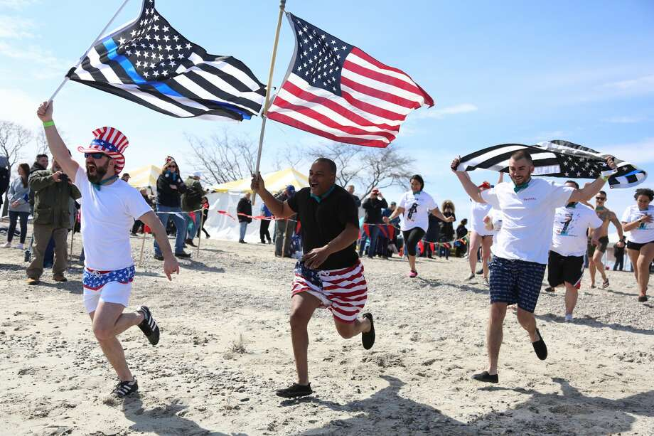 The Westport Penguin Plunge was held at Compo Beach on April 7, 2018. The Penguin Plunge is the largest grassroots fundraiser to benefit Special Olympics Connecticut. Brave plungers were encouraged to wear costumes; prizes were awarded to the best ones. Were you SEEN? Photo: Derek Sterling/Hearst CT Media