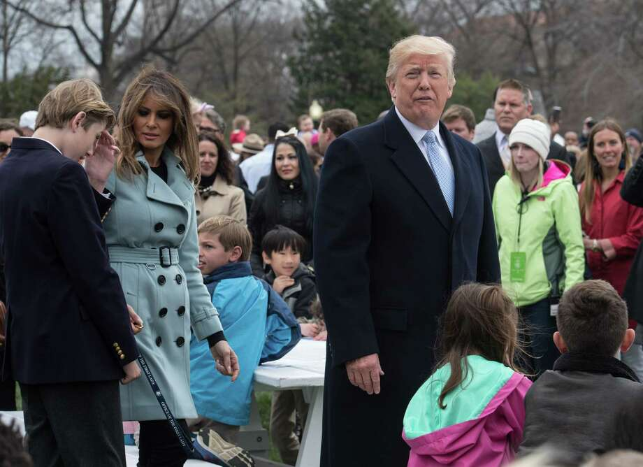 US President Donald Trump, First Lady Melania Trump and their son Barron attend the annual Easter Egg Roll at the White House in Washington, DC, on April 2, 2018. / AFP PHOTO / NICHOLAS KAMMNICHOLAS KAMM/AFP/Getty Images Photo: NICHOLAS KAMM / AFP or licensors