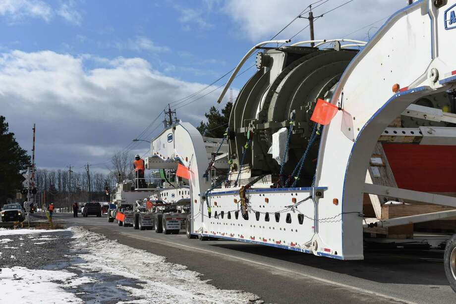 A 450-ton General Electric turbine is transported on Burdeck St. (Route 337) on Friday, Jan. 27, 2017, in Rotterdam, N.Y.  According to GE, the unit is the first of its kind to be built in Schenectady and the largest ever to be shipped fully assembled by truck. (Will Waldron / Times Union) Photo: Will Waldron / 20039555A