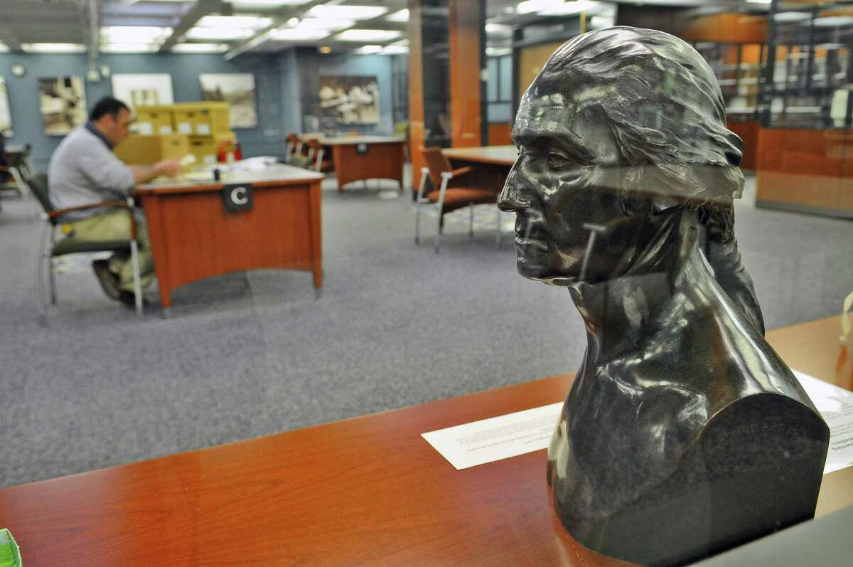 A bronze bust of George Washington from 1877 that had survived the Capitol fire of March 29, 1911, sits in the New York State Library on Thursday March 10, 2011 in Albany, NY. The bust was returned to the library in 1921. It was also in the office of Governor Franklin Delano Roosevelt afterwards. ( Philip Kamrass / Times Union )