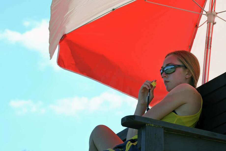 Lifeguard Alexis Smith keeps a watchful eye on swimmers at Grafton Lakes State Park on Wednesday July 27, 2016 in Grafton, N.Y. State swimming areas will have extended hours through Thursday during the current heat wave. (Michael P. Farrell/Times Union) Photo: Michael P. Farrell / 20037449A