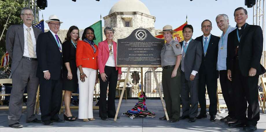 Officials gather for a photo around the plaque that will be placed on display at the World Heritage Inscription Ceremony at Mission San Jose on in October 2015. Officials pictured are (left to right): Michael Bean, deputy assistant Interior Secretary; Bexar County Judge Nelson Wolff; Alamo Director Becky Dinnin; Mayor Ivy Taylor; Interior Secretary Sally Jewell; National Parks Service Superintendent Mardi Arce; Mexican Counsel General Jose Larios Ponshe; Spanish Cultural Attache Enric Panes; U.S. Rep. Lloyd Doggett and Archbishop Gustavo Garcia-Siller. Last year, Dinnin became executive director of the Remember the Alamo Foundation, an endowment subsidiary created to raise funds for promotion and implementation of the Alamo master plan. She resigned last week, saying she wants to pursue other opportunities. Photo: Kin Man Hui /San Antonio Express-News / ©2015 San Antonio Express-News