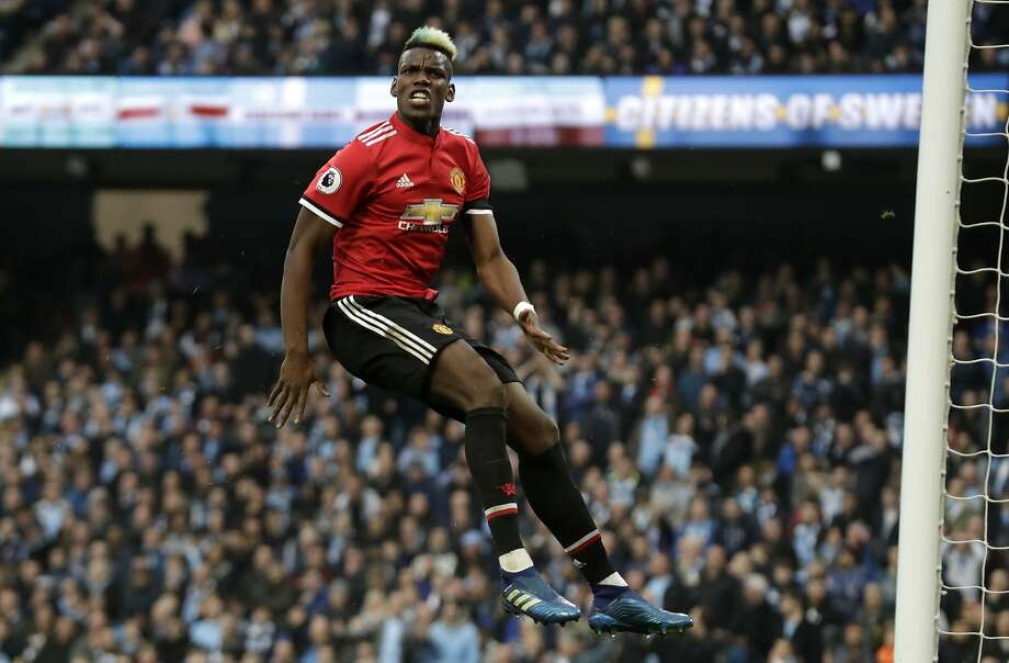Manchester United's Paul Pogba reacts after scoring his side's second goal during the English Premier League soccer match between Manchester City and Manchester United. Photo: Matt Dunham / Associated Press