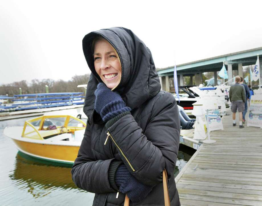 "Bundled-up in a winter coat, Teri Hanchar of Westchester, N.Y., said  ""Too cold,"" as she commented on the 39-degree temperature while walking on the dock during the 10th annual Greenwich Boat Show at the Greenwich Water Club in the Cos Cob section of Greenwich, Conn., Saturday, April 7, 2018. Photo: Bob Luckey Jr. / Hearst Connecticut Media / Greenwich Time"