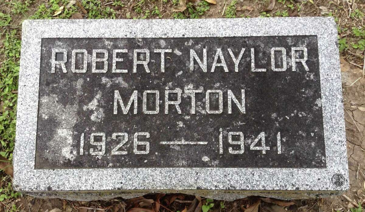 This stone marks the grave in Mission Burial Park South of Robert Naylor Morton, who died of a gunshot wound to the head at the age of 14; a rifle was found at his feet and he was alone in his room. Two of his older brothers - Arthur, 15, and Harry, 14 - died of gunshot wounds in 1932; it was deemed they had shot each other accidentally. All three boys are buried in a family plot at Mission Burial Park South. Their parents, Brazzilla Naylor Morton and Arthur Morton, also are buried there.