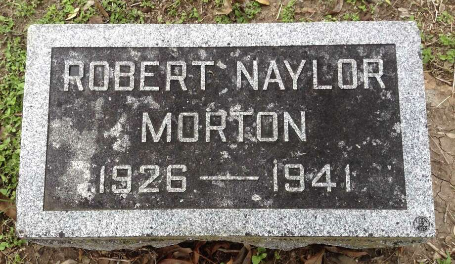 This stone marks the grave in Mission Burial Park South of Robert Naylor Morton, who died of a gunshot wound to the head at the age of 14; a rifle was found at his feet and he was alone in his room. Two of his older brothers — Arthur, 15, and Harry, 14 — died of gunshot wounds in 1932; it was deemed they had shot each other accidentally. All three boys are buried in a family plot at Mission Burial Park South. Their parents, Brazzilla Naylor Morton and Arthur Morton, also are buried there. Photo: Courtesy / Bill And Denise /