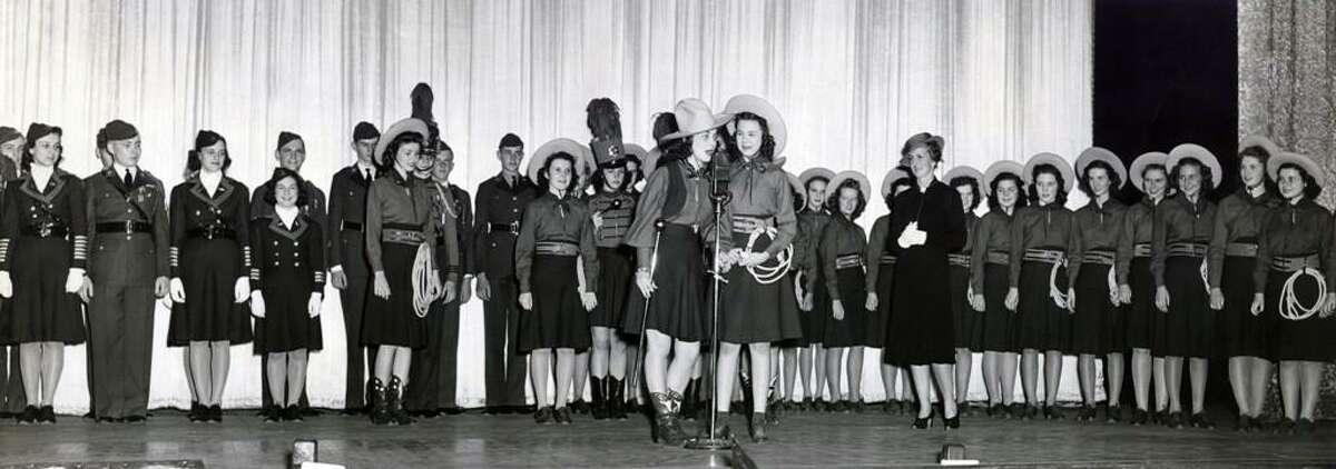 """The Jefferson High School Lassos are shown with actress Jane Withers at the Majestic Theatre premiere of """"High School"""" in 1940. The Lassos, the high school's """"unique pep squad,"""" appeared in the movie, which starred Withers as a member of the trick-roping, western-clad group."""