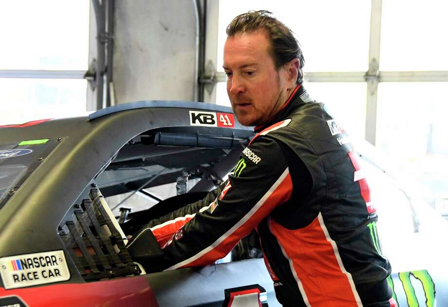 Kurt Busch reaches into his car in the garage area during a practice session for a NASCAR Cup series auto race in Fort Worth, Texas, Saturday, April 7, 2018. (AP Photo/Larry Papke) Photo: Larry Papke, FRE / FR58581 AP