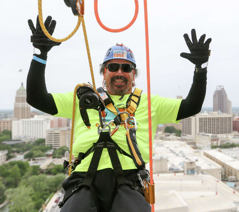 "Rick Castillo goes ""hands free"" before rappeling from the 19th floor of the Marriott Rivercenter, 100 Bowie St. in Boysville, Inc.'s ""Over the Edge"" fundraising event on Saturday, April 7, 2018.  MARVIN PFEIFFER/mpfeiffer@express-news.net Photo: Marvin Pfeiffer, San Antonio Express-News / Express-News 2018"