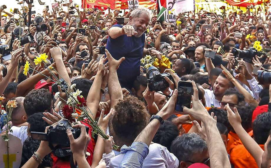 Former Brazilian President Luiz Inacio Lula da Silva waves to supporters at the headquarters of a metalworkers union in Sao Bernardo do Campo, in metropolitan Sao Paulo. Photo: Miguel Schincariol / AFP / Getty Images
