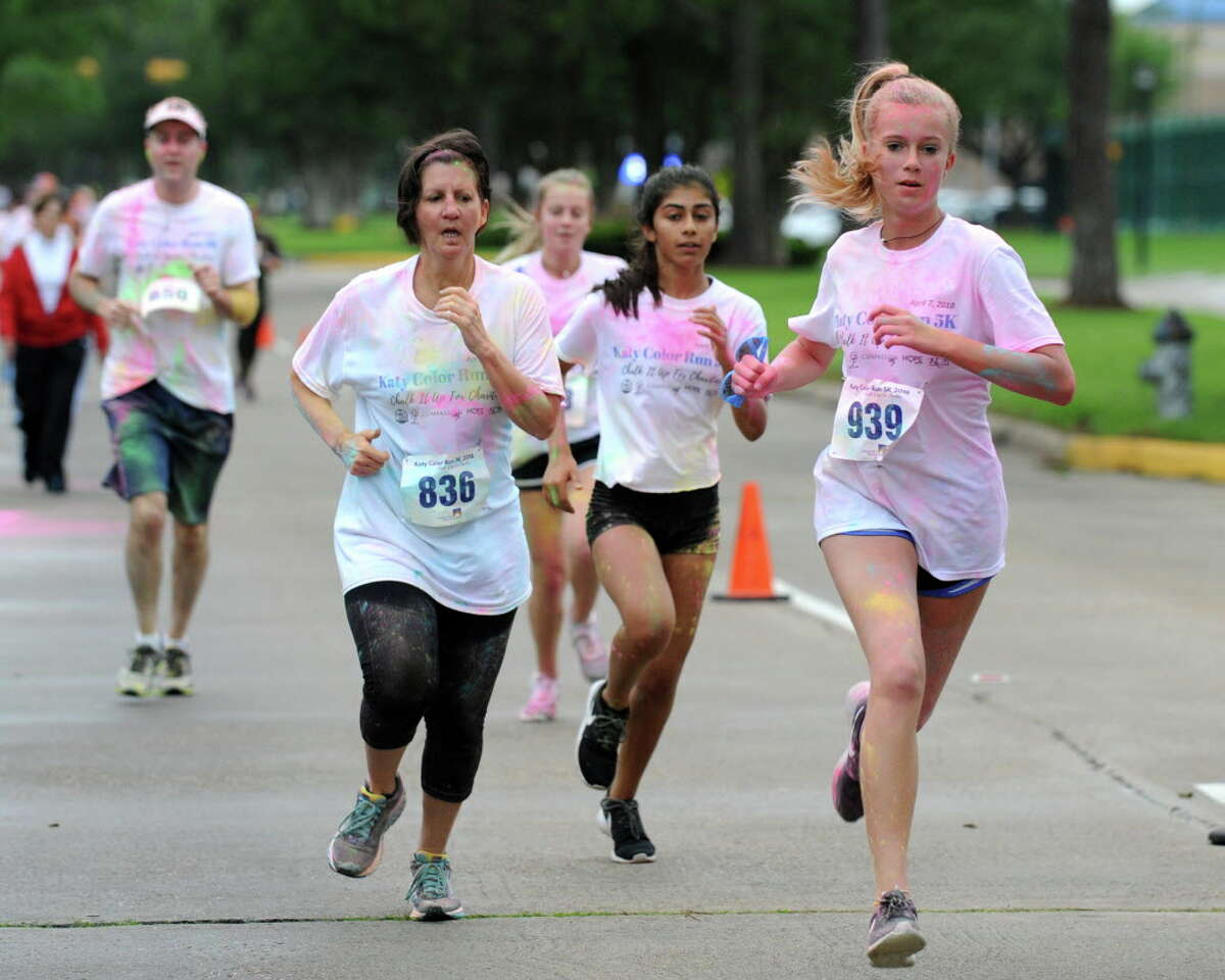 Participants complete the 5K at the Katy Color Run in Katy, TX on Saturday, April 7, 2018.