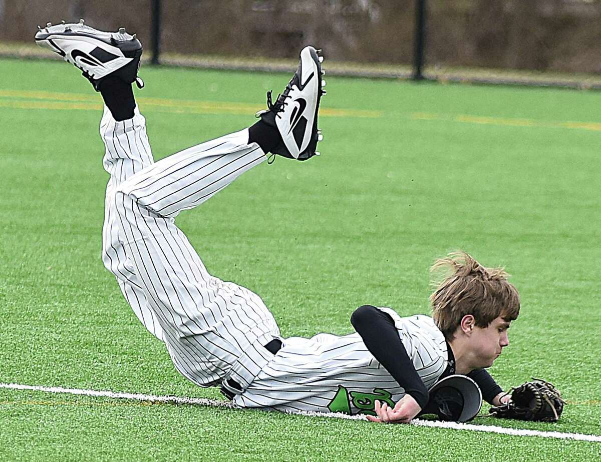 Norwalk freshman second baseman Brendan Edvardsen dives to knock down a ground ball deep in the hole during Saturday's 10-6 loss to East Haven the Callahan Complex in Norwalk.