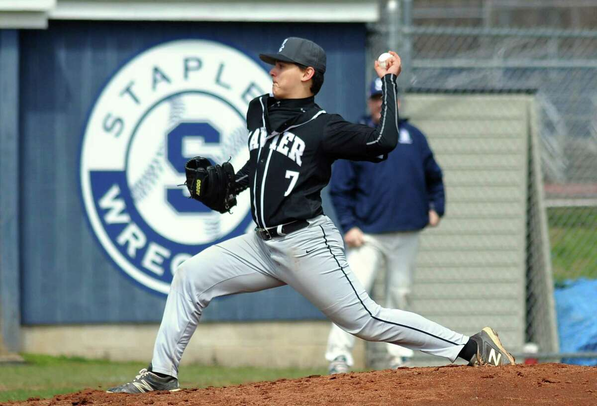 Xavier's Ray Seward pitches during baseball action against Staples in Westport, Conn., on Saturday Apr. 7, 2018.
