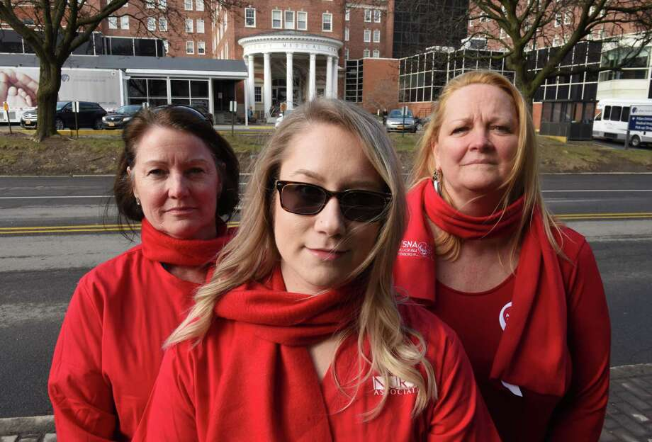 Albany Medical Center pro-union nurses; Patty Pinho, left, Lisa Eberhart, center, and Karen Nieto, right, stand for a photo outside the hospital on Friday, April 6, 2018, on New Scotland Ave. in Albany, N.Y. Nurses at Albany Medical Center will vote next week on whether to join the New York State Nurses Association, the state's largest nursesO union. (Will Waldron/Times Union) Photo: Will Waldron / 20043451A