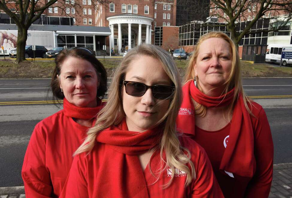 Albany Medical Center pro-union nurses; Patty Pinho, left, Lisa Eberhart, center, and Karen Nieto, right, stand for a photo outside the hospital on Friday, April 6, 2018, on New Scotland Ave. in Albany, N.Y. Nurses at Albany Medical Center will vote next week on whether to join the New York State Nurses Association, the state's largest nursesO union. (Will Waldron/Times Union)