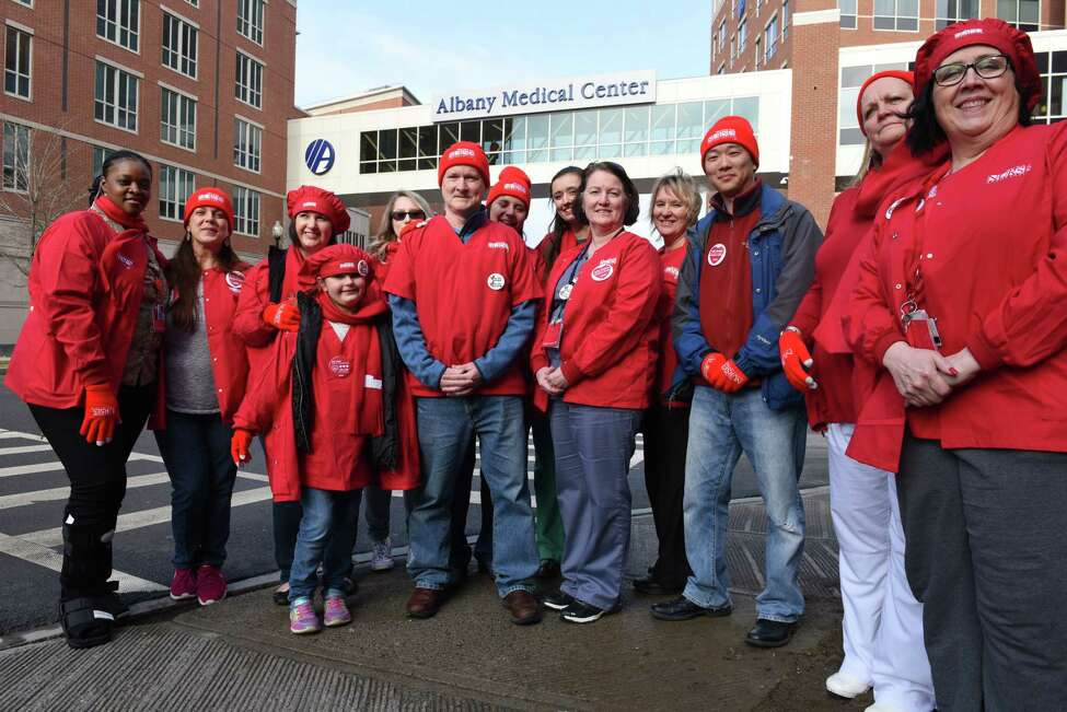 Albany Medical Center nurses who support unionization stand for a photo on Friday, April 6, 2018, in Albany, N.Y. Nurses at Albany Medical Center will vote next week on whether to join the New York State Nurses Association, the state's largest nursesO union. (Will Waldron/Times Union)