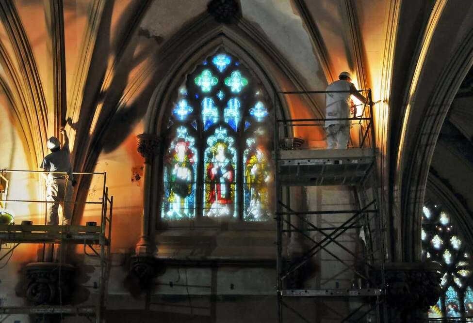 Painters Dan Lagacy, left, and Mark Brewer inside the nearly-completed extensive interior renovation of the historic Cathedral of the Immaculate Conception in Albany Thursday afternoon Nov. 19, 2009. (John Carl D'Annibale / Times Union)