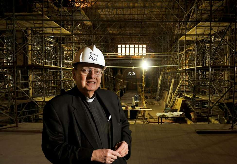Father William Pape inside the nearly-completed extensive interior renovation of the historic Cathedral of the Immaculate Conception in Albany Thursday afternoon Nov. 19, 2009. (John Carl D'Annibale / Times Union)