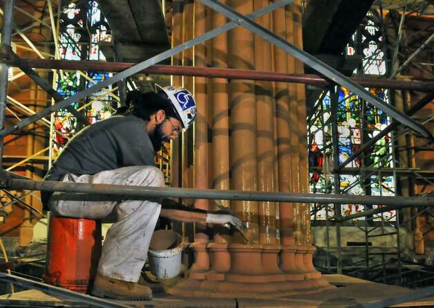 Painter Fred McIntosh works on an interior column inside... 239958 ...