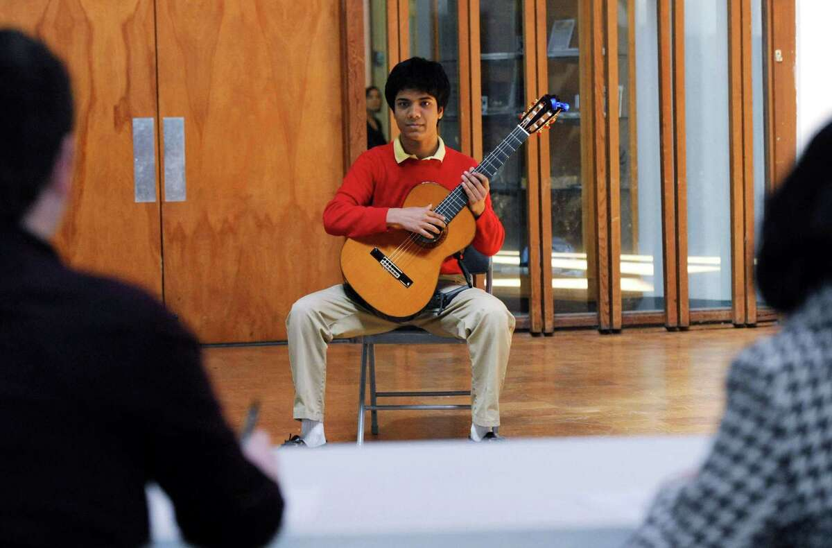 Nikhil Goswami, 16, of Westport talks with the judges as The Connecticut Guitar Academy hosts its first guitar competition where students 18 and under vie for the $2,000 grand prize in the semifinals on Saturday, April 7, 2018, at Temple Shalom in Norwalk, Conn.