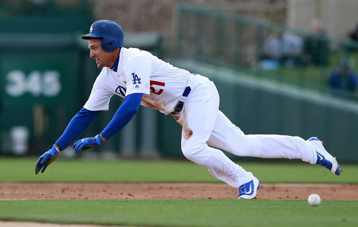 FILE - In this Feb. 23, 2018, file photo, Los Angeles Dodgers' Trayce Thompson steals second during the team's spring training baseball game against the Chicago White Sox in Glendale, Ariz.T he Dodgers have cut Thompson, the brother of Golden State Warriors star Klay Thompson. Thompson was competing for a spot in a crowded Los Angeles outfield that includes Chris Taylor, Yasiel Puig, Matt Kemp, Joc Pederson and Andrew Toles. Thompson was designated for assignment by the defending NL champions to make room on the 40-man roster for right-hander Cory Mazzoni, who was claimed off waivers from the Chicago Cubs. (AP Photo/Carlos Osorio, File)