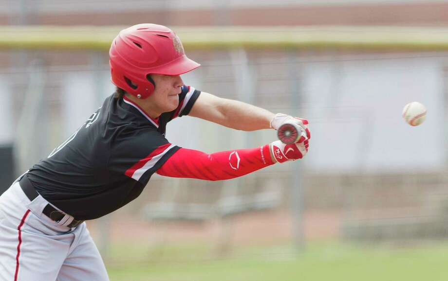 Tayler Baker #6 of Porter bunts the ball in the third inning of a high school baseball game during the Don Newcomb Classic, Friday, March 2, 2018, in Porter. Photo: Jason Fochtman, Staff Photographer / © 2018 Houston Chronicle