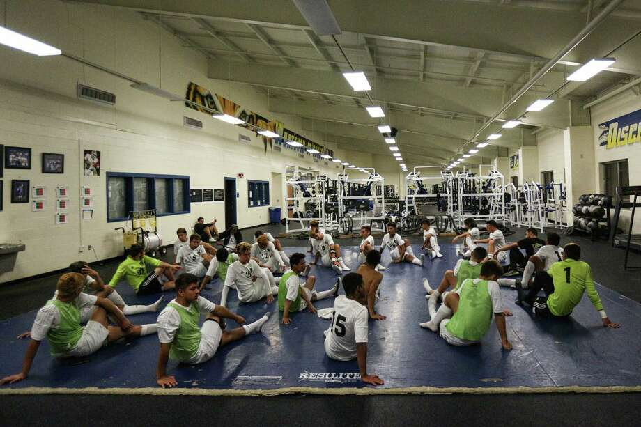 Conroe Tigers stretch while waiting for a weather delay to be lifted during the boys soccer game against Pearce on Friday, April 6, 2018, at Corsicana High School. (Michael Minasi / Houston Chronicle) Photo: Michael Minasi, Staff Photographer / © 2018 Houston Chronicle