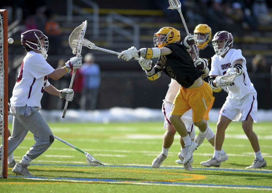 Brunswick's Christian Ronda (8) breaks the inside crease and scored in the first quarter after firing a shot past Loomis Chaffee goalie Macon Jeffreys on Saturday. Photo: Matthew Brown / Hearst Connecticut Media / Stamford Advocate