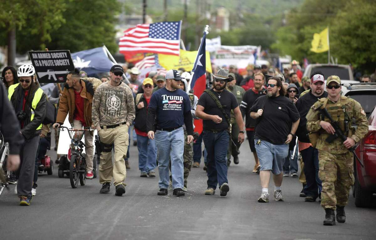 Members of Open Carry Texas and supporters stage a march in Olmos Park on Saturday, April 7, 2018. They were demanding that police chief Rene Valenciano lose his job over what they say is unfair treatment of their members.