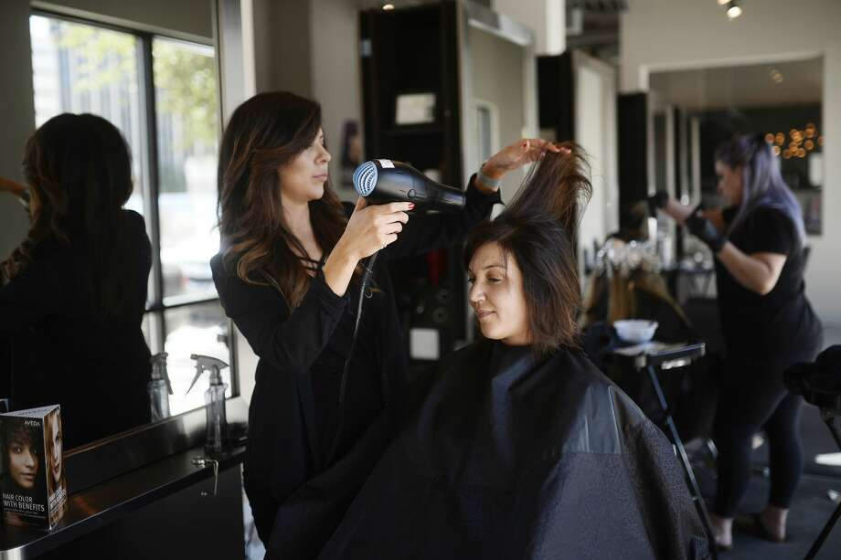 Chrissy Hale, owner of Halo Hair and Beauty Bar, works with Katie Jerath April 7, 2018.  James Durbin/Reporter-Telegram Photo: James Durbin