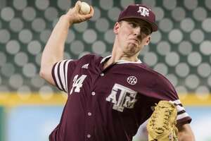 Texas A&M pitcher Mitchell Kilkenny (34) warms-up before a NCAA baseball game at Minute Maid Park on Sunday, Mar. 5, 2017, in Houston. (Joe Buvid / For the Houston Chronicle)