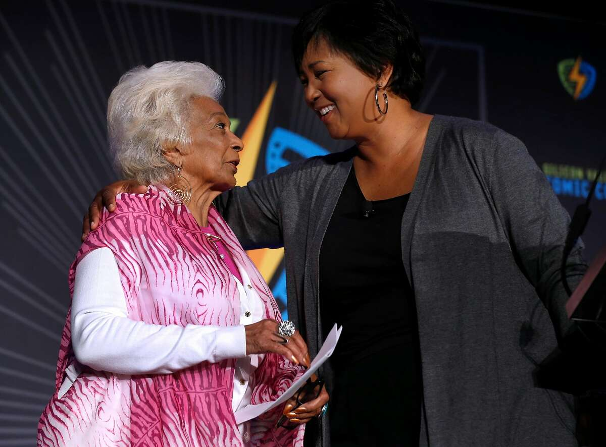 Actress Nichelle Nichols, who portrayed Lt. Uhura in the original Star Trek series, introduces NASA astronaut Dr. Mae Jemison to an audience at the Silicon Valley Comic Con in San Jose, Calif. on Saturday, April 7, 2018.