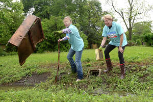 Elizabeth Waddill (left) and Melanie Heartfield toss debris from a ditch along Marie Street as they join in the clean-up efforts throughout Pear Orchard during the 2018 Beaumont Trash-Off, which was held in conjunction with a statewide event. Over 800 volunteers signed up for the event, heading to areas throughout the city which inspectors identified as being the worst in terms of litter and trash.  Photo taken Saturday, April 7, 2018 Kim Brent/The Enterprise